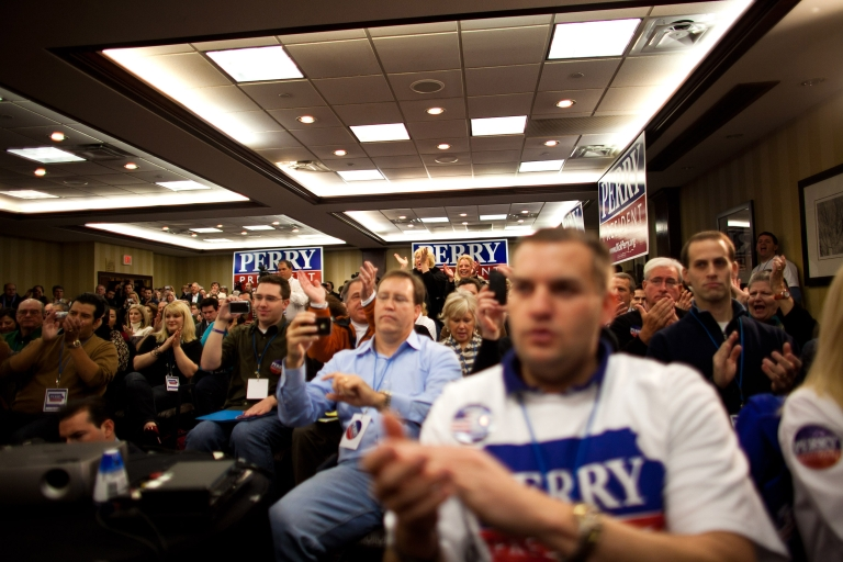 <p>Supporters cheer while Republican presidential candidate, Texas Gov. Rick Perry speaks with potential voters during a caucus training session held at the Sheraton January 3, 2012 in West Des Moines, Iowa. After months of campaigning by candidates, Iowan voters throughout the state prepare to participate in the first caucus of the 2012 presidential election.</p>