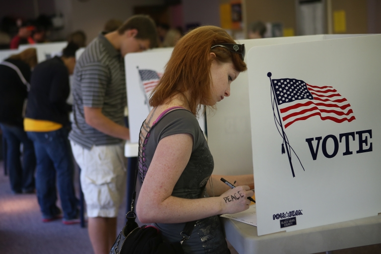 <p>Student Courtney Johnson votes on the campus of the University of Northern Iowa on Sept. 28, 2012 in Cedar Falls, Iowa. Voters filled the polling place which had been set up on campus for early voting following a nearby rally with first lady Michelle Obama.</p>