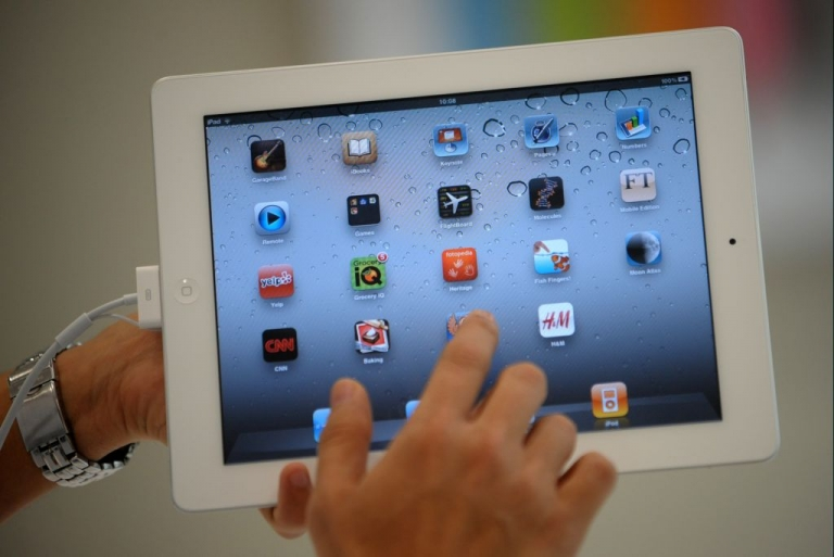 <p>A man navigates through the new iPad 2 during its launch in the Philippines at an Apple store in Manila on April 29, 2011.</p>