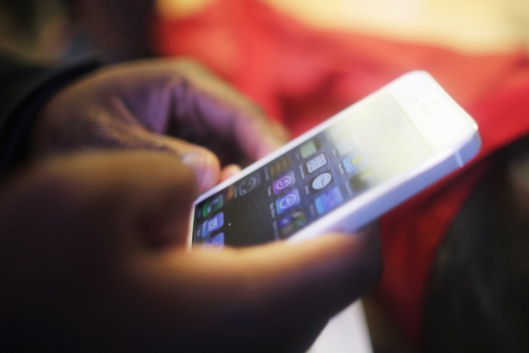 <p>A customer tries out the Apple iPhone 5 inside the Apple Fifth Avenue flagship store on the first morning it went on sale on September 21, 2012 in New York City.</p>