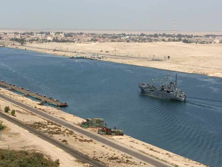 <p>An Egyptian patrol ship navigates the Suez Canal between Port Said and Ismailia, about 100 kms northeast of Cairo.</p>