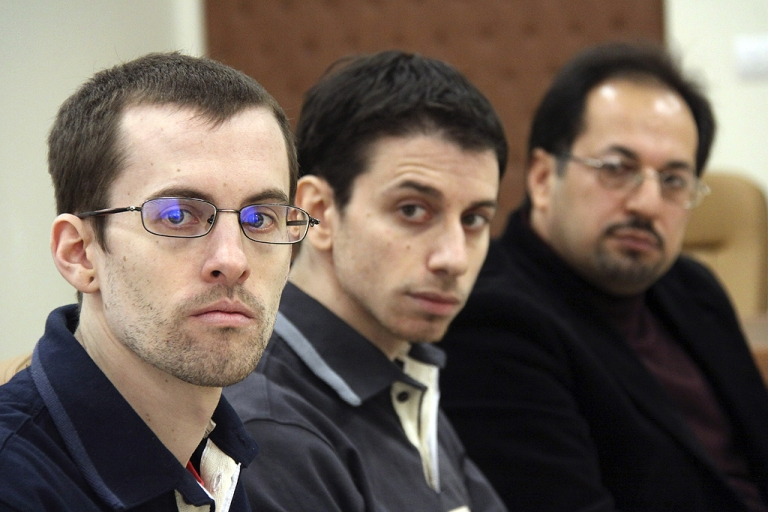 <p>A picture released by Iran's state-run Press TV shows US hikers Shane Bauer (L) and Josh Fattal (C), detained in Iran on spying charges, sitting next to an unidentified translator during the first session of their trial at the Tehran Revolutionary Court in the Iranian capital on February 6, 2011, more than 18 months after their arrest on the unmarked border with Iraq during a hiking trip.</p>