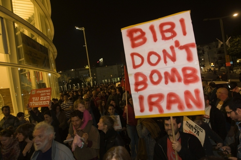 <p>An Israeli anti-war protester holds a sign asking Prime Minister Benjamin Netanyahu not to bomb Iran during a demonstration in Tel Aviv on March 24, 2012.</p>