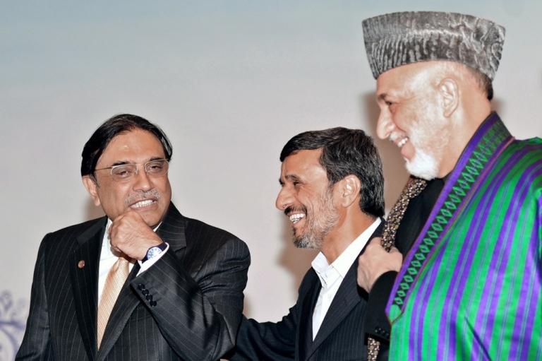 <p>Pakistan President Asif Ali Zardari (L), Iran President Mahmoud Ahmedinejad (C) and Afghanistan President Hamid Karzai (R) chat after a meeting in Istanbul on Dec. 23, 2010.</p>