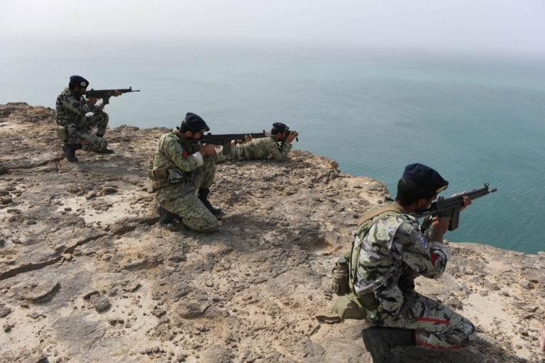 <p>Iranian Soldiers aim during navy exercises in the Sea of Oman near the Iranian port of Bandar Jask, in southern Iran on Dec. 30, 2011.</p>