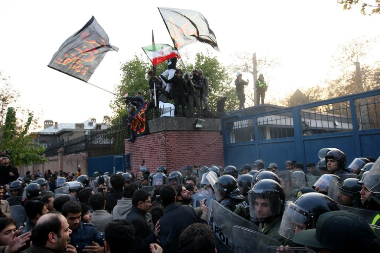 <p>Iranian protesters storm the British Embassy in Tehran, November 29, 2011. Police dispersed the crowd with tear gas.</p>