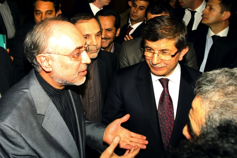 <p>Iranian Foreign Minister Ali Akbar Salehi (L) and his Turkish counterpart Ahmet Davutoglu (R) talk to journalists before a meeting in Tehran on January 4, 2012. The European Union and the United States tightened today the sanctions noose around Iran, with diplomats in Brussels saying a preliminary agreement had been reached on an EU embargo of Iranian oil. The West's double squeeze on Iran adds to existing sanctions imposed over Tehran's nuclear programme that is increasingly destabilising the Islamic republic oil-dependent economy</p>