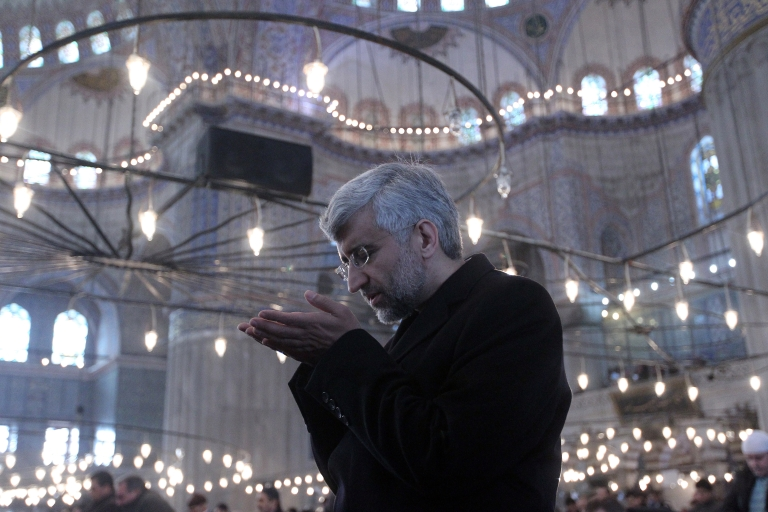 <p>Iran's chief nuclear negotiator, Said Jalili, prays during Friday prayers at the Blue mosque on Jan 21 in Istanbul.</p>