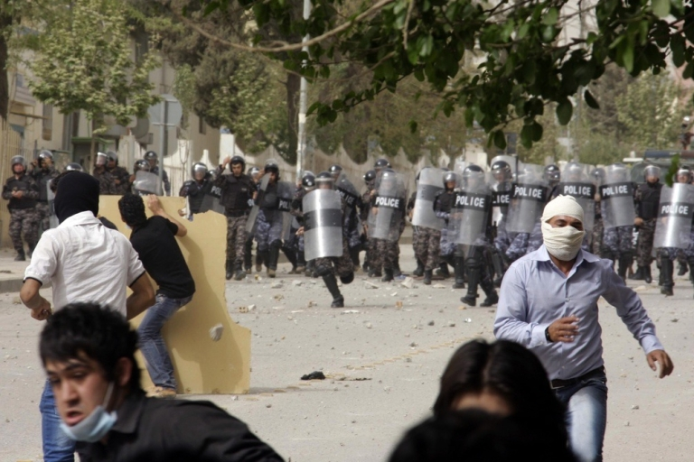 <p>Iraqi Kurdish demonstrators run for cover from riot police during clashes following a protest in the Kurdish city of Sulamaniyah on April 18, 2011.</p>