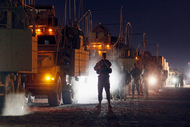 <p>U.S. Army soldiers from the 2-82 Field Artillery, 3rd Brigade, 1st Cavalry Division, wait to load onto their armored vehicles as they prepare to convoy to Kuwait from Camp Adder in Iraq on December 7, 2011 at Camp Adder, near Nasiriyah, Iraq. After seven months in Iraq, the 3rd Brigade is pulling out of the country as part of America's military exodus by the end of December after eight years of war and occupation which included the overthrow of Saddam Hussein.</p>