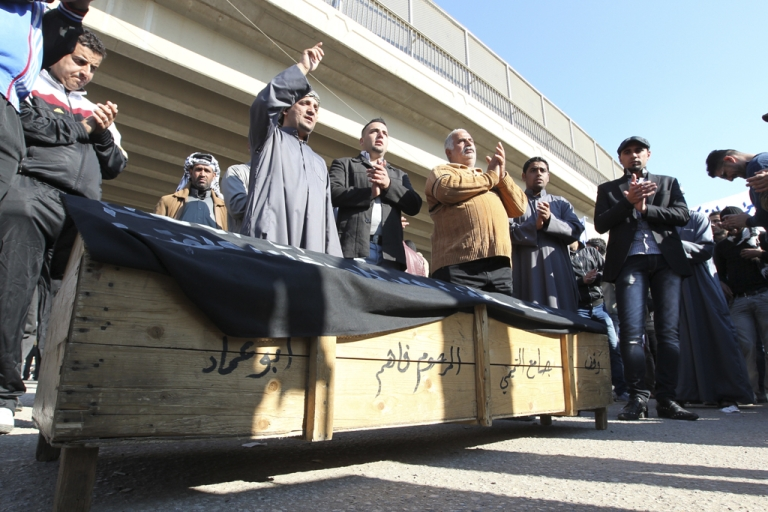 <p>Iraqis take part in a political protest last month demanding the resignation of Sunni Muslim Vice President Tareq al-Hashemi after a judicial committee investigation issued an warrant for his arrest.</p>