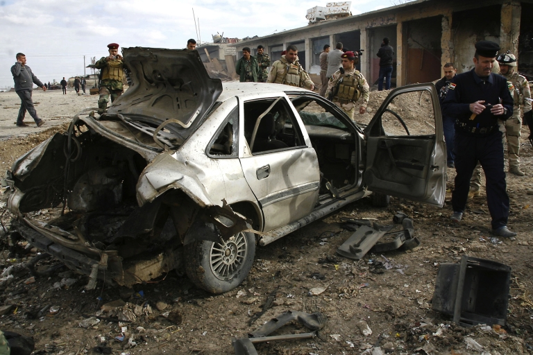 <p>Two car bombs set off in Iraq killed at least 11 people.</p>