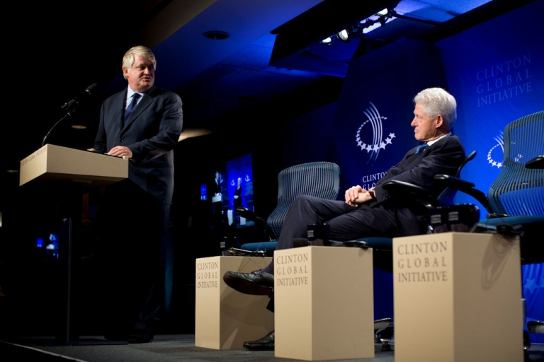 <p>Denis O'Brien, chairman of Digicel, converses with former U.S. President Bill Clinton before the panel session