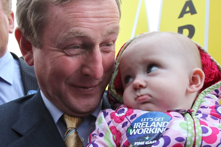 <p>The center-right Fine Gael party, led by Enda Kenny, will form a new Irish government after winning the election. Here Kenny smiles as he holds 6-month-old May Hennelly during the campaign.</p>