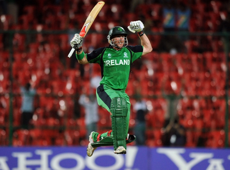<p>Ireland's John Mooney celebrates after Ireland beat England in a Cricket World Cup match in Bangalore, India on March 2, 2011.</p>
