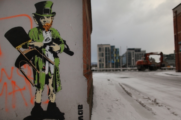 <p>A street artist's picture of a traditional Leprechaun is daubed on a wall of an empty building in the docklands area in Dublin on Dec. 1, 2010. The Irish economy has faltered after years of growth and EU finance ministers approved an aid package totaling 85 billion euros.</p>