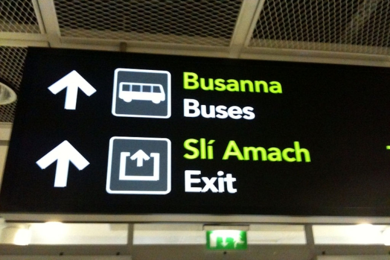 <p>Signs in Irish, or Gaelic, and English greet passengers arriving at Dublin Airport. (Conor O'Clery/GlobalPost)</p>