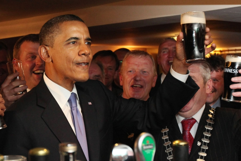 <p>U.S. President Barack Obama enjoys a glass of Guinness in his ancestral home of Moneygall, Ireland, on May 23, 2001. On his one-day visit to Ireland, Obama met with distant relatives in Moneygall and spoke in Dublin.</p>