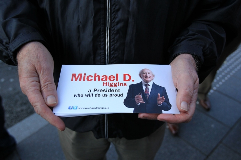 <p>Michael D. Higgins looks set to become Ireland's next president.  In this photo a supporter hands out the presidential candidate's leaflets in Kilkenny on Oct. 25, 2011.</p>