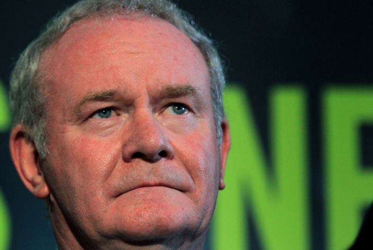 <p>Sinn Fein's Martin McGuinness stands with party colleagues as he prepares to speak to the media during a press conference, after being officially chosen by his party to be the candidate for the upcoming Irish Presidential election, at the Writers' Centre in Dublin, on September 18, 2011.</p>