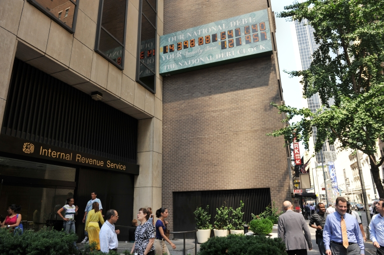 <p>The National Debt Clock, a billboard-size digital display showing the increasing US debt, near an office of the Internal Revenue Service on Sixth Avenue in New York City on July 26, 2011.</p>