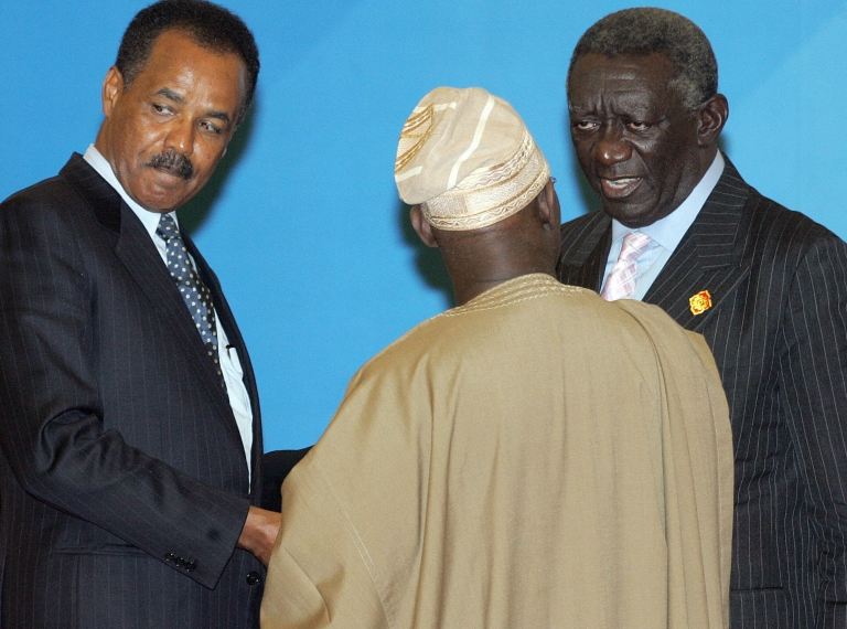 <p>President of Eritrea Isaias Afewerki (L) chats with Nigerian President Olusegun Obasanjo (C) and Ghanaian President John Agyekum Kufuor (R) following a two-day China-Africa summit in Beijing in November 2006.</p>