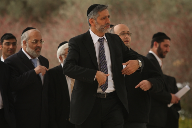 <p>Eli Yishai, (C) head of the ultra-Orthodox Shas party, arrives for a meeting with President Shimon Peres to advise the veteran Israeli politician on his choice to head a new coalition government February 19, 2009 in Jerusalem.</p>