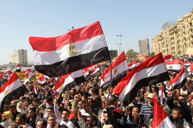<p>Thousands of Egyptians hold up their national flag as they gather following Friday prayers celebrating the end of former President Hosni Mubarak's regime and the success of their revolution in Cairo's Tahrir Square on March 4, 2011.</p>