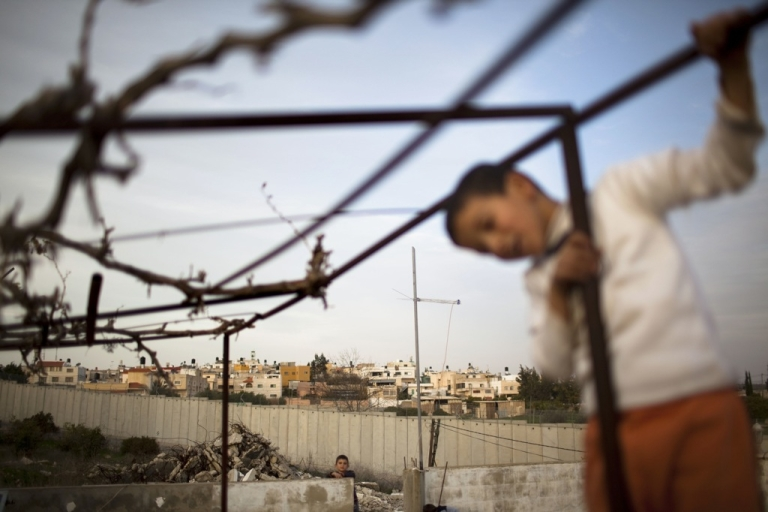 <p>BAKA AL GARBIYEH, ISRAEL - JANUARY 25: (ISRAEL OUT) Palestinian children play on their roof backdropped by Israel's separation barrier on January 25, 2011 in Baka al-Garbiyeh, Israel.</p>
