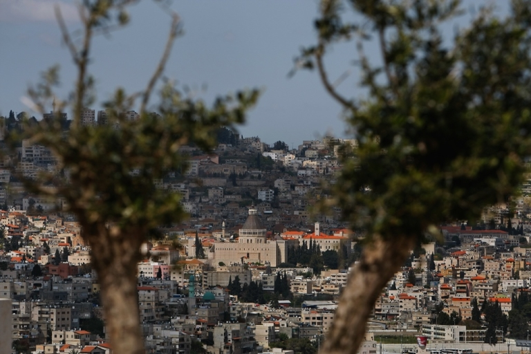 <p>The Galilee town of Nazareth in northern Israel, seen between the branches of an olive tree.</p>
