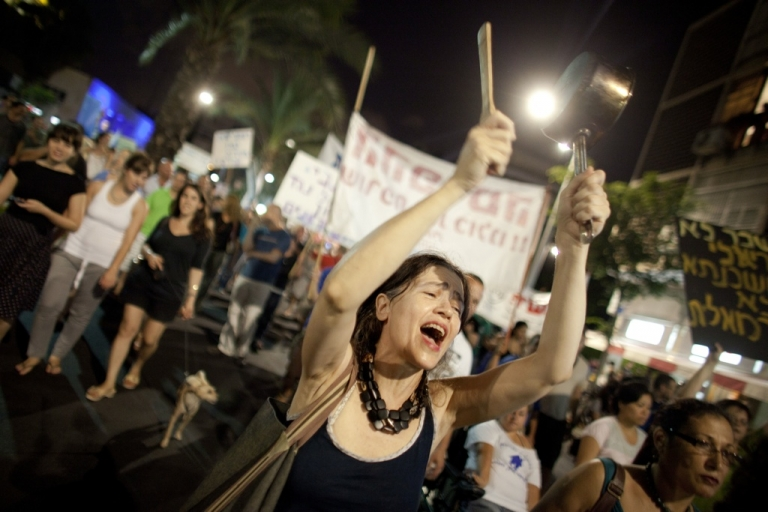 <p>Israelis march to protest against rising housing prices and social inequalities on July 23, 2011 in Tel Aviv, Israel.</p>