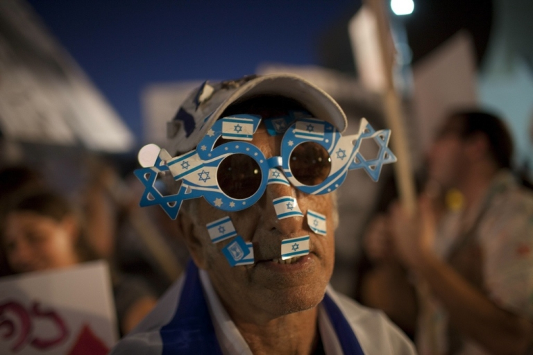 <p>One of an estimated 400,000 Israelis demonstrates in the center of Tel Aviv on Sept. 3, 2011 protesting against rising housing prices and social inequalities in the Jewish state.</p>