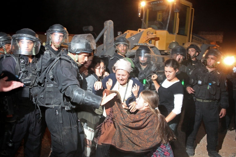 <p>Israeli riot police scuffle with Jewish settlers as structures are dismantled in the West Bank outpost settlement of Migron in September.</p>