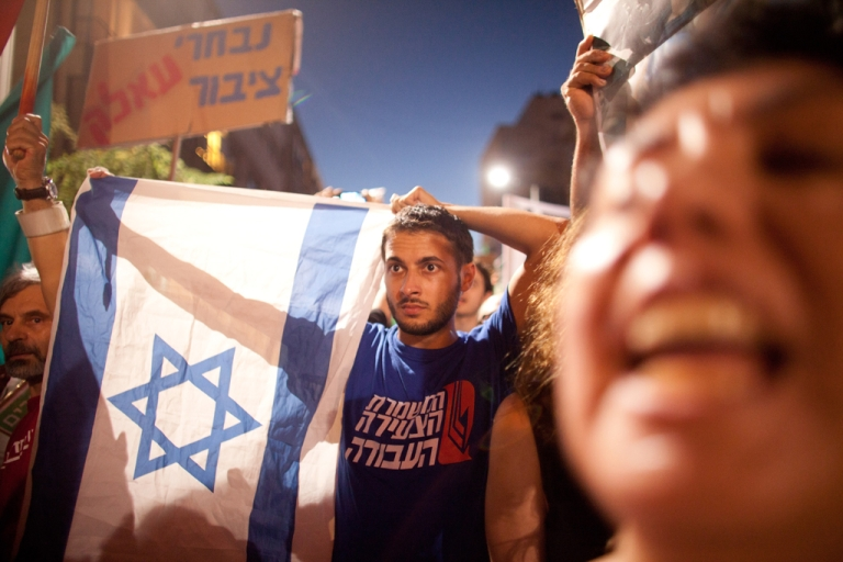 <p>Demonstrators march through the streets to protest rising housing costs on July 14, 2012 in Tel Aviv, Israel.</p>