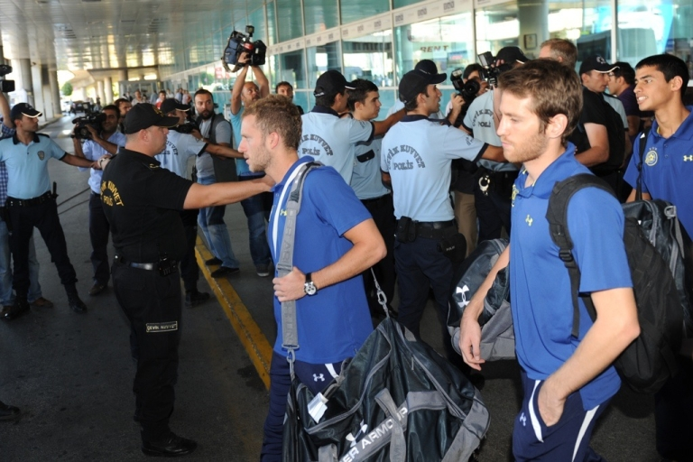 <p>Turkish riot police stand guard as Maccabi Tel-Aviv players walk towards a bus at Ataturk Airport in Istanbul, on Sept. 14, 2011.</p>