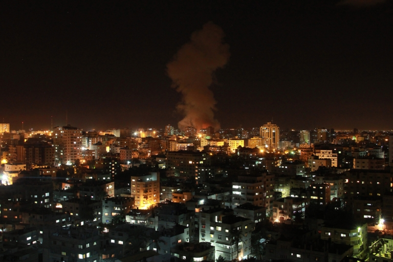 <p>Smoke rises following an Israeli air strike on a house in Gaza City, on November 14, 2012.  Israel killed a top Hamas military commander in a targeted strike in Gaza, prompting outrage from militants who said the Jewish state had opened