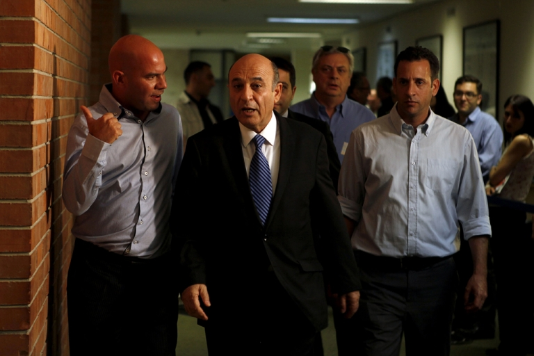 <p>Shaul Mofaz (C), Chairman of the Kadima party, arrives for a special faction meeting at the Knesset (Israel's Parliament) on July 11, 2012 in Jerusalem. Mofaz said on July 17, 2012 that Kadima was leaving the government coalition.</p>