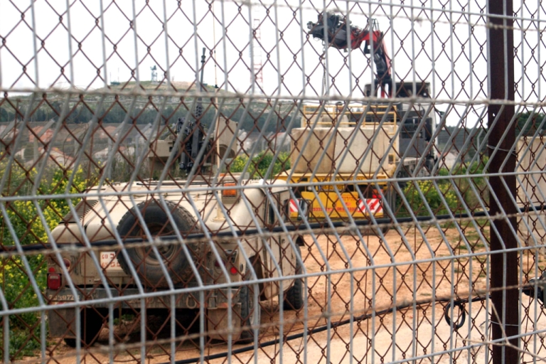 <p>Seen from across the southern Lebanese border, an Israeli armored vehicle stands by as huge cement blocks are placed forming part of a separation barrier between the two nations near the Fatima Gate on March 11, 2012.</p>
