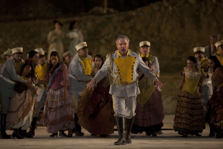 <p>Opera singers and actors perform during a full dress rehearsal of George Bizet's opera 'Carmen' on a special stage set up against the backdrop of the ancient hilltop fortress of Masada, southern Israel, on June 6, 2012.</p>