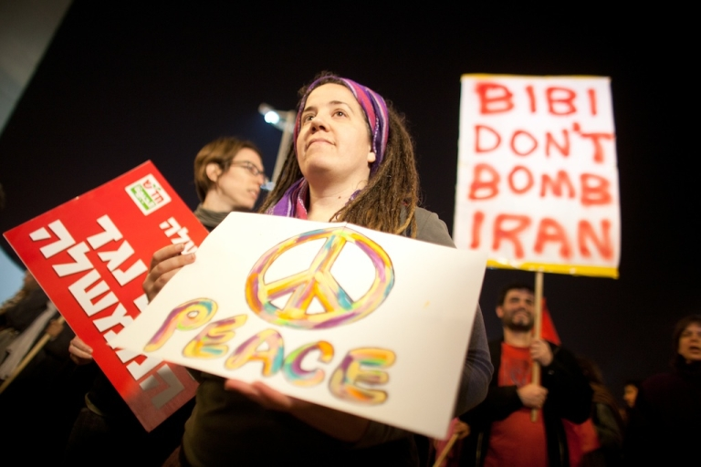 <p>Israelis demonstrate against a possible Israeli military attack and war with Iran on March 24, 2012 in Tel Aviv, Israel. As the balance between war and diplomacy continually teeters, Israel's leaders are afraid that a nuclear-armed Iran is an existential threat and if negotiation efforts fail, Israel could strike this year.</p>