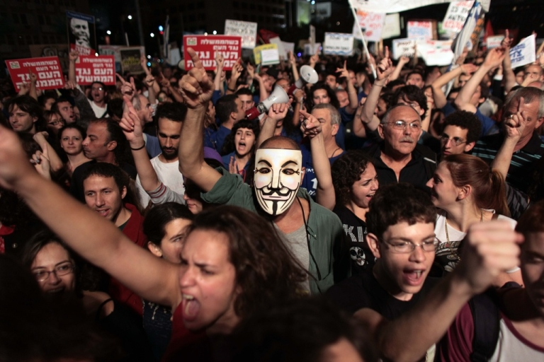 <p>Israelis angered by the spiraling cost of living chant slogans during a protest in Tel Aviv's downtown Rabin Square on Oct. 29, 2011.</p>