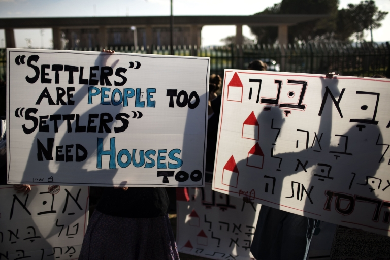 <p>Dozens of Israeli settlers demonstrate in November in front of the Knesset, Israel's parliament in Jerusalem against their government's decision to dismantle some of the West Bank settlements.</p>