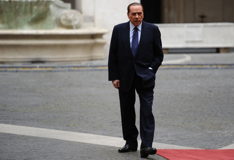 <p>Italian Prime Minister Silvio Berlusconi waits for the arrival of the President of the Swiss Confederation Micheline Calmy-Rey on June 1, 2011 at Palazzo Chigi in Rome.</p>