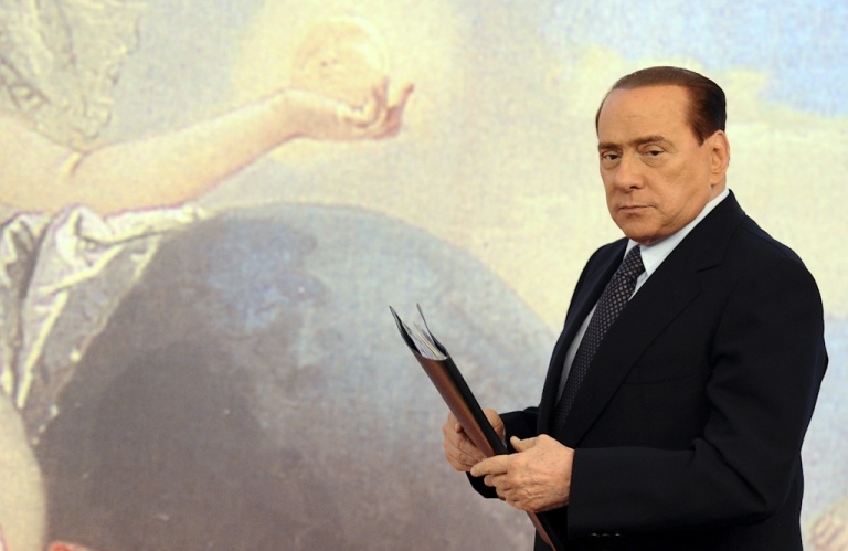 <p>Italian Prime Minister Silvio Berlusconi arrives for a news conference at the Chigi palace on August 5, 2011. On August 12, 2011, Italy's Cabinet approved $64.12 million in cuts over the next two years to balance the budget by 2013 to meet demands of European Central Bank.</p>