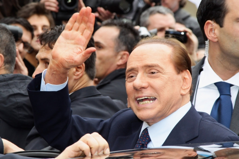 <p>Italian Prime Minister Silvio Berlusconi waves after a court hearing on March 28, 2011 in Milan, Italy. Berlusconi, who is already a defendant in two ongoing trials, said he wanted to attend the hearing so he could defend himself in front of the Italian people.</p>