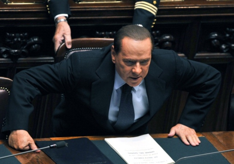 <p>Italian Prime Minister Silvio Berlusconi in Rome, on October 14, 2011 prior to the start of a confidence vote session. Berlusconi won the crucial confidence vote amid infighting in his ruling coalition as well as growing criticism over his handling of the economy and mounting legal scandals.</p>