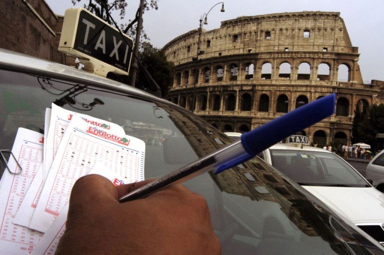 <p>A taxi driver plays Italy's SuperEnaLotto in 2003 as the jackpot reached $75 million. The government is expanding gambling online to help balance solve its fiscal crisis.</p>