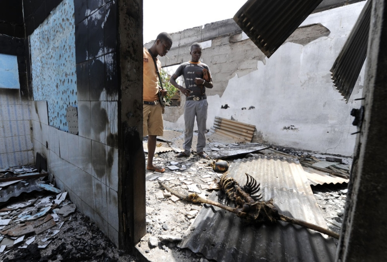 <p>A nasty kind of war. A burned skeleton lies on the floor in a house in Duekoue, Ivory Coast, after forces loyal to President Alassane Ouattara swept through town. Amnesty International accuses both Ouattara's and ex-president Laurent Gbagbo's security forces of atrocities</p>