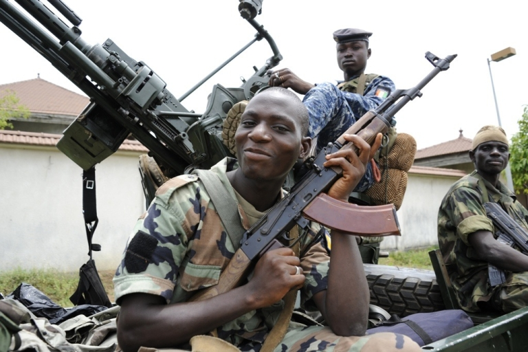 <p>Pro-Ouattara militiamen on patrol in a district of Abidjan on April 13, 2011. Ivory Coast's President Alassane Ouattara said he would move into the palace once occupied by arrested strongman predecessor Laurent Gbagbo