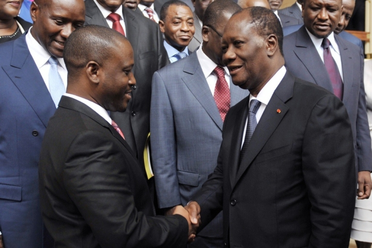 <p>Ivory coast President Alassane Ouattara, right, and Prime Minister Guillaume Soro, left, shake hands after the first cabinet meeting since a new government was announced two days before, at Abidjan's Presidential Palace on June 3, 2011. The government faces the tough task of reconciling a country torn apart by the violence, especially in the west, where more than a million people were killed in the post-election crisis, according to the United Nations.</p>